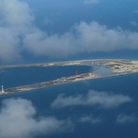 Chinese-held Subi Reef, in the Spratly Island chain of the disputed South China Sea, is seen in April 2017.  | POOL / VIA REUTERS