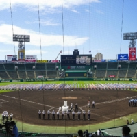 The opening ceremony of this summer's National High School Baseball Championship is held at Koshien Stadium in Nishinomiya, Hyogo Prefecture, on Tuesday. | KYODO