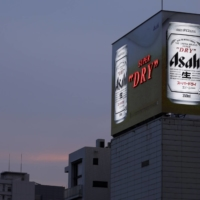 Sales of Asahi Breweries Ltd.'s Asahi Super Dry beer rose 30% in July from a year earlier.   BLOOMBERG