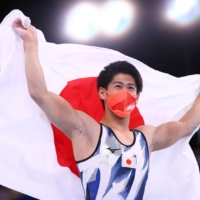 Gymnast Daiki Hashimoto celebrates winning a gold medal at the Tokyo Games. An analysis of all Summer Olympics held since 1992 shows that the single most powerful driver of medal tally is hosting the event and how many years since a country last did so. | REUTERS