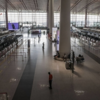 A deserted departure hall at Beijing Capital International Airport on Thursday | BLOOMBERG