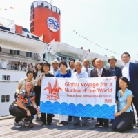 Hibakusha participants and staff of an Orizuru Project voyage made on the occasion of the 70th anniversary of the atomic bombings return to Yokohama in July 2015. | COURTESY OF PEACE BOAT / VIA KYODO