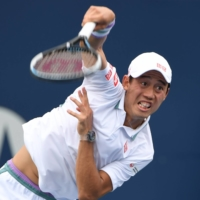 Kei Nishikori of Japan serves against Miomir Kecmanovic of Serbia in second round play in the National Bank Open, in Toronto, on Tuesday. | DAN HAMILTON / USA TODAY SPORTS / VIA REUTERS