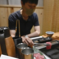 A grilled meat restaurant in Nagoya is giving discounts to customers who can prove they have been vaccinated. | KYODO