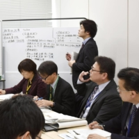 Internal affairs ministry officials hold a disaster response drill in February of 2020. | KYODO