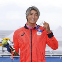 Kanoa Igarashi poses with her silver medal after the Tokyo Olympic surf competition at Tsurigasaki Surfing Beach in Chiba Prefecture on July 27.  |  KYODO