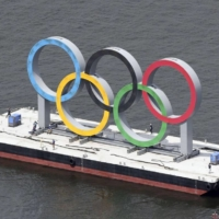 The giant floating Olympics rings monument set up at Odaiba Marine Park in Tokyo is removed Wednesday to be replaced with the symbol for the Paralympics.   KYODO