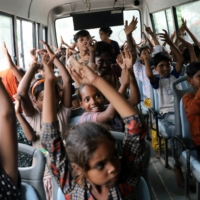 A TejasAsia class on a 'Hope Bus' on Monday | REUTERS