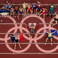 Decathlon athletes pose for a group photo after competing. With more competitors taking to social media to talk about their experience, some talked about previously taboo topics such as mental health.  | REUTERS