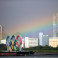 A rainbow appears over Tokyo during a women's triathalon event in Odaiba Marine Park. Though it doesn't look like the Olympics will provide the city with any sort of pot of gold, much of Japan was instead satisfied with the record number of gold medals that their country took home from this year's Games. | REUTERS