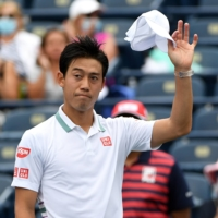 Japan's Kei Nishikori waves to fans after defeating Miomir Kecmanovic of Serbia in Toronto on Tuesday. | USA TODAY SPORTS / VIA REUTERS
