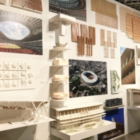 A wall of models and plans of Kengo Kuma's National Stadium design greets visitors to 'Kuma Kengo: Five Purr-fect Points for a New Public Space,' the architect's first major solo exhibition at The National Museum of Modern Art, Tokyo.   © MIO YAMADA