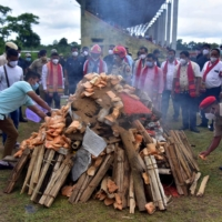 Assam Police personnel burn seized drugs during a ceremony at a playground in the Karbi Anglong district. | REUTERS