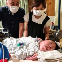 The goal of Hidetaka Mizuno (left) and his wife, Mutsumi, is for their daughter Hikari to live on her own after they die. | NISHINIPPON SHIMBUN