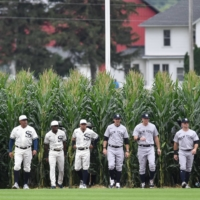 The White Sox and Yankees enter the field before the 'Field of Dreams' game in Dyersville, Iowa, on Thursday.   USA TODAY / VIA REUTERS