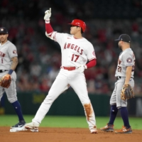 Los Angeles Angels designated hitter Shohei Ohtani reacts after hitting an RBI single in the eight inning on Friday.  | USA TODAY / VIA REUTERS