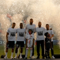 PSG's summer signings, including goalkeeper Gianluigi Donnarumma (center) and forward Lionel Messi (right), pose during a presentation ceremony prior to the team's first-division game against Strasbourg on Saturday in Paris. | AFP-JIJI