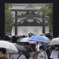 People visit Yasukuni Shrine in Tokyo on Sunday, the 76th anniversary of Japan's surrender in World War II.  | KYODO