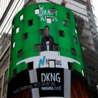 DraftKings' CEO Jason Robins appears on the Nasdaq MarketSite jumbotron ahead of the company's initial public offering, in New York on June 11. | REUTERS