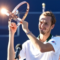 Daniil Medvedev poses with his trophy after defeating Reilly Opelka in the finals of the ATP Toronto Masters on Sunday.    USA TODAY / VIA REUTERS