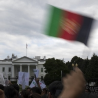 Demonstrators protest the U.S. military's pullout of Afghanistan as the Taliban moved into Kabul, at the White House in Washington on Sunday.   | TOM BRENNER/THE NEW YORK TIMES
