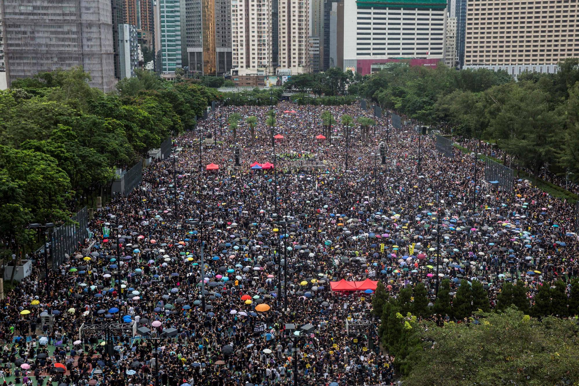 Protesters gather for a rally in Hong Kong's Victoria Park in August 2019. The protest coalition that organized record-breaking democracy rallies two years ago has said it will disband.   | AFP-JIJI