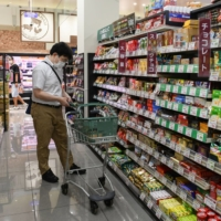 Consumption in the April-June quarter rebounded, but the outlook for the Japanese economy remains modest amid a spike in COVID-19 infections. | BLOOMBERG