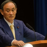 Prime Minister Yoshihide Suga told reporters Monday that the government decided to propose the emergency expansion to an expert panel, adding that it is his duty to make every effort to resolve the issues at hand. | REUTERS