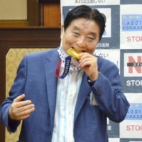 Japan's medal-munching mayor may soon see a bite taken out of his paycheck