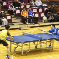Para men's table tennis player Koyo Iwabuchi (right) plays in the Iwabuchi Open, which he organized, in November 2020 in Tokyo.   KYODO
