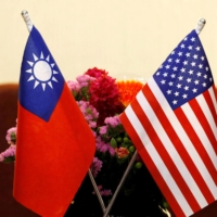 The flags of Taiwan and the U.S. ahead of a meeting in Taipei in March 2018 | REUTERS