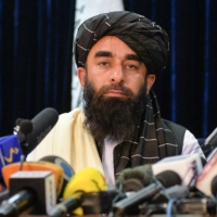 Taliban spokesman Zabihullah Mujahid addresses the group's first news conference in Kabul on Tuesday, following its stunning takeover of Afghanistan.   AFP-JIJI