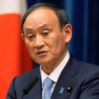 Prime Minister Yoshihide Suga speaks during a news conference at the Prime Minister's Office on Tuesday.   POOL / VIA REUTERS