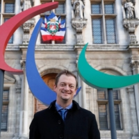 IPC President Andrew Parsons in Paris in 2017. Parsons said the decision to ban spectators will have 'an impact that we cannot minimize,' but he believes a global TV audience will still put the Paralympics center stage. | AFP-JIJI