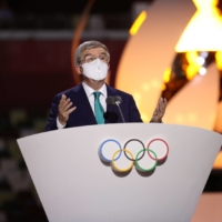IOC President Thomas Bach delivers a speech next to Tokyo 2020 President Seiko Hashimoto during the closing ceremony of the Olympics on Aug. 8.   POOL / VIA REUTERS