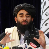 A high-ranking Taliban spokesman speaks during a news conference in Kabul on Tuesday. Most assessments assume there is little daylight between the Taliban and al-Qaida. In reality, they have very different objectives. | REUTERS