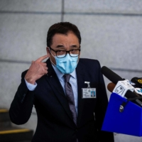 Steve Li, senior superintendent of the Hong Kong's national security police unit, speaks to the media outside Wanchai police station in Hong Kong on Wednesday.  | AFP-JIJI