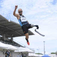 Atsushi Yamamoto, a member of Japan's men's track and field team, competes in the long jump at a competition in Aichi Prefecture in June. | KYODO