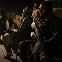 Taliban fighters at a checkpoint in central Kabul on Tuesday    JIM HUYLEBROEK / THE NEW YORK TIMES