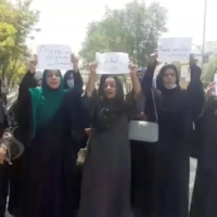 A group of women hold a protest calling on the Taliban to protect their rights, in Kabul, Afghanistan, on Tuesday.   SHAMSHAD NEWS / VIA REUTERS