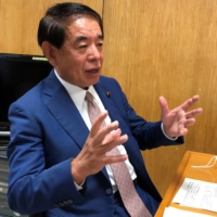 Hakubun Shimomura, the ruling Liberal Democratic Party's policy chief, speaks during an interview in 2020.   REUTERS