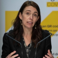 New Zealand Prime Minister Jacinda Ardern speaks about COVID-19 cases during a news conference in Wellington on Wednesday.  | AFP-JIJI