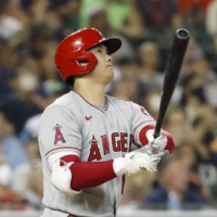 Shohei Ohtani hits a solo home run against the Tigers during the eighth inning in Detroit on Wednesday.   KYODO