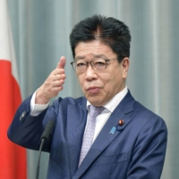 Chief Cabinet Secretary Katsunobu Kato answers questions during a news conference on Thursday. | KYODO