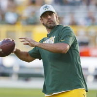 Packers quarterback Aaron Rodgers  throws a pass during warmups before a preseason game against the Texans in Green Bay, Wisconsin, on Aug. 14. | USA TODAY / VIA REUTERS