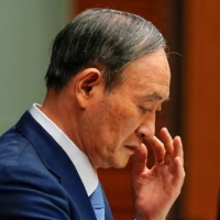 In a sign of deepening doubt about Prime Minister Yoshihide Suga's leadership and accountability, one third of respondents of the Reuters Corporate Survey expected the ruling coalition to lose many seats in the next Lower House election.   POOL / VIA REUTERS
