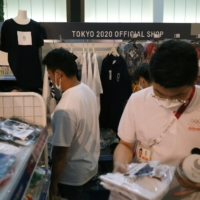 People shop in an official Olympics store in Tokyo on July 30.    REUTERS