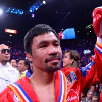 Manny Pacquiao, seen entering the ring for a fight on July 20, 2019, will try to win back the WBA title on Saturday. | USA TODAY / VIA REUTERS