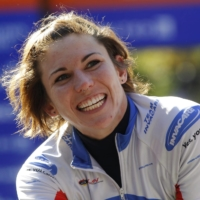 Amanda McGrory smiles after winning the women's wheelchair division of the 2011 New York City Marathon on Nov. 6, 2011 in New York. | REUTERS