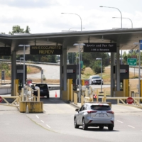 A vehicle approaches the U.S.-Canada border to enter the U.S., which is still closed to Canadians for nonessential travel.   AFP-JIJI